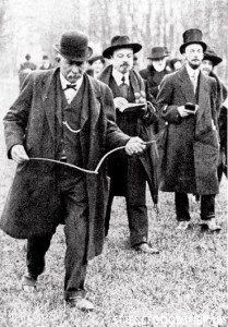 "Dowsing. Man using a forked rod whilst divining for underground water (""dowsing"") during the early 20th century. The divining (meaning ""finding"") rod is held loosely in the practitioner's hands and spontaneously points upwards or downwards when he passes over an underground object such as a spring. Although still used widely, divining has no scientific basis and there is no conclusive evidence that it works."